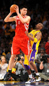 LOS ANGELES - MAY 4: Yao Ming #11 of the Houston Rockets handles the ball against Kobe Bryant #24 of the Los Angeles Lakers in Game One of the Western Conference Semifinals during the 2009 NBA Playoffs at Staples Center on May 4, 2009 in Los Angeles, California. NOTE TO USER: User expressly acknowledges and agrees that, by downloading and/or using this Photograph, user is consenting to the terms and conditions of the Getty Images License Agreement. Mandatory Copyright Notice: Copyright 2009 NBAE (Photo by Noah Graham/NBAE via Getty Images)